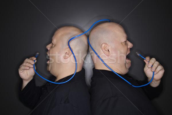 Technológia kaukázusi kopasz felnőtt azonos iker Stock fotó © iofoto