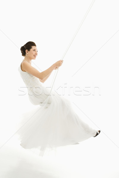 Bride swinging. Stock photo © iofoto
