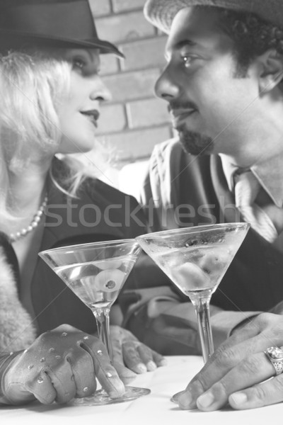 Retro couple at bar. Stock photo © iofoto