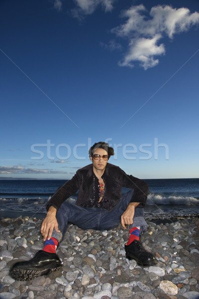 Uomo seduta spiaggia Foto d'archivio © iofoto