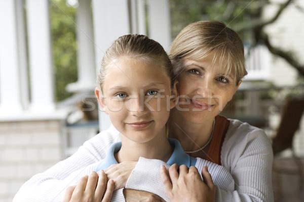 Mom and daughter hugging. Stock photo © iofoto