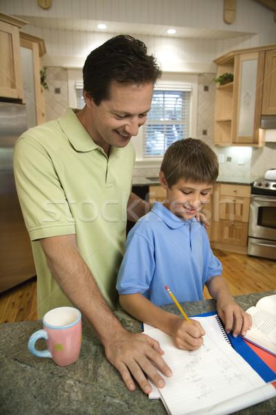 Apa fiú kaukázusi apa segít házi feladat Stock fotó © iofoto