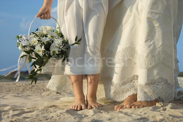 Bride and Flower Girl on Beach Stock photo © iofoto