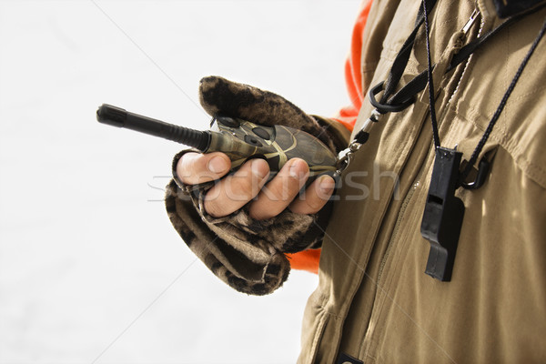 Hand holding walkie talkie. Stock photo © iofoto