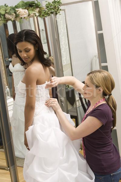 Seamstress helping bride. Stock photo © iofoto