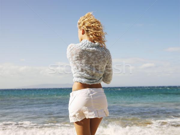 Woman looking at ocean Stock photo © iofoto
