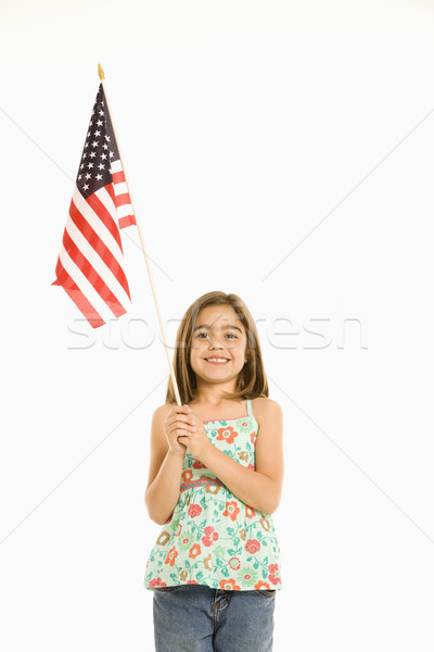 Girl holding American flag. Stock photo © iofoto