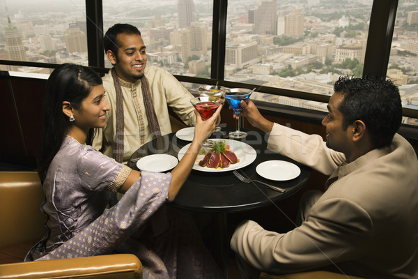 People Toasting in Restaurant Stock photo © iofoto