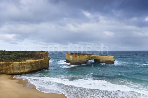 Sahil kaya oluşumu kemer biçim muhteşem okyanus Stok fotoğraf © iofoto