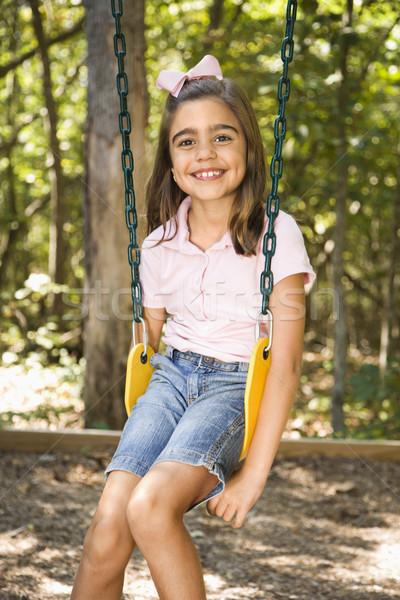 Dziewczyna huśtawka hiszpańskie posiedzenia uśmiechnięty dzieci Zdjęcia stock © iofoto