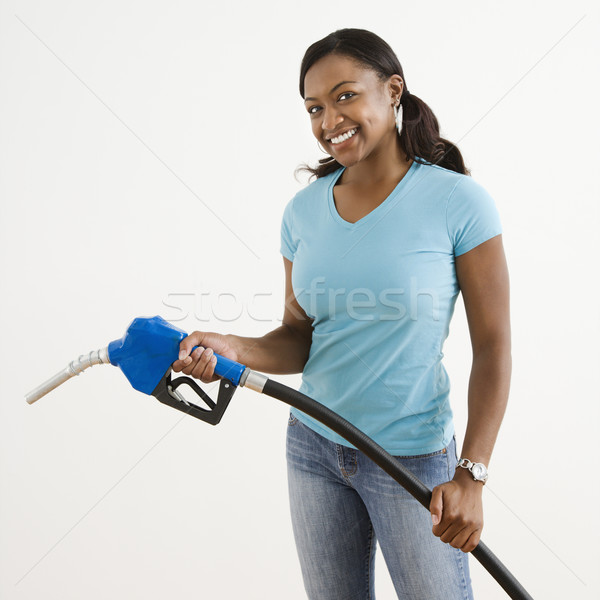 Nő benzin fúvóka afroamerikai fiatal felnőtt női Stock fotó © iofoto