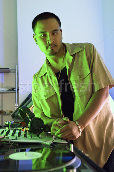 Male DJ with turntable. Stock photo © iofoto