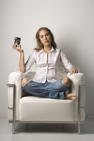 Young Woman Sitting in Chair with Camera Stock photo © iofoto