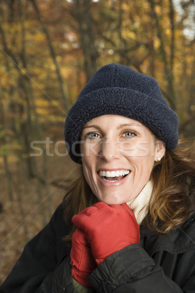 Smiling woman in woods. Stock photo © iofoto