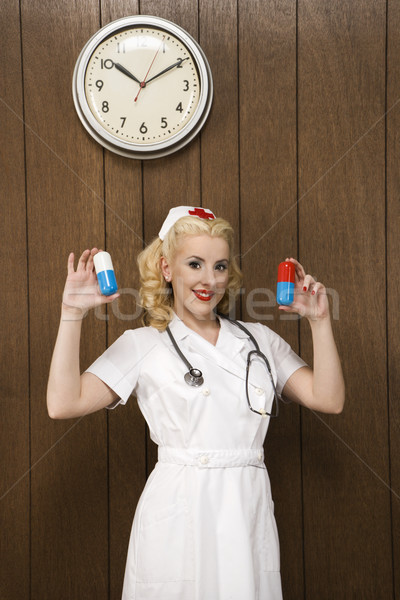 Retro nurse with pills. Stock photo © iofoto