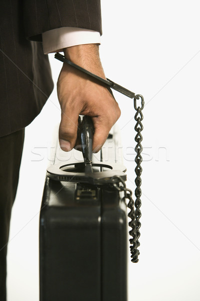 Businessman locked to briefcase. Stock photo © iofoto