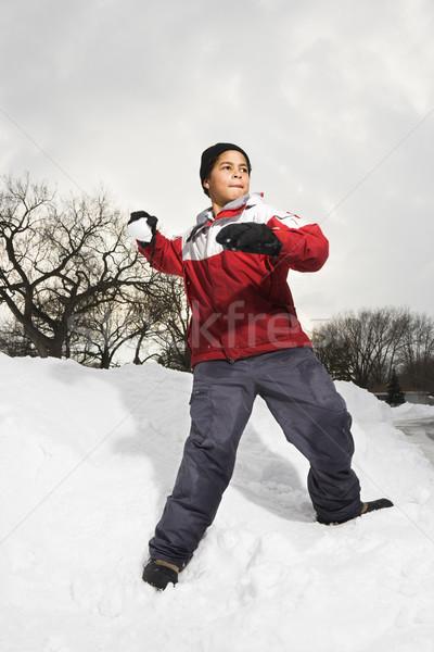 Boy throwing snowball. Stock photo © iofoto