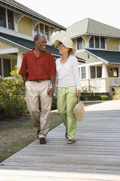 Szczęśliwy para spaceru w średnim wieku trzymając się za ręce Zdjęcia stock © iofoto