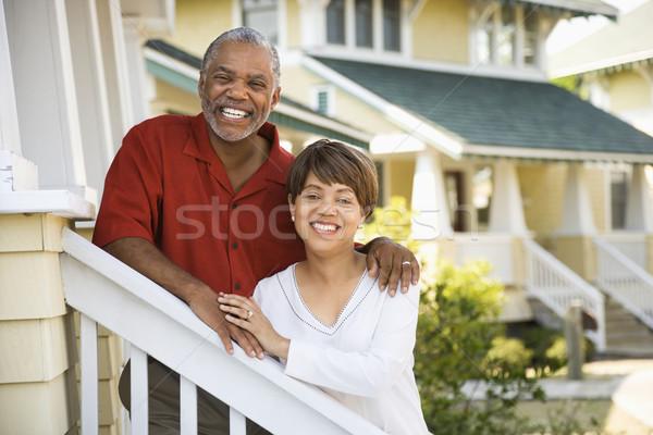 Szczęśliwy para w średnim wieku stałego wraz Zdjęcia stock © iofoto
