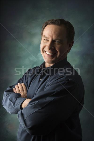 Smiling man portrait. Stock photo © iofoto