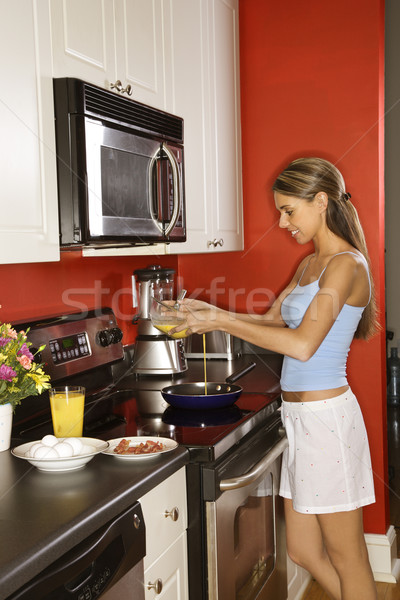 Attractive Young Woman in Kitchen Cooking Breakfast Stock photo © iofoto