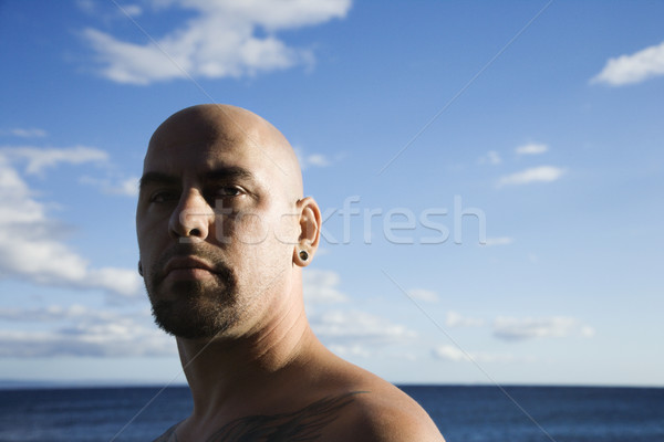 Adult bald male on beach. Stock photo © iofoto