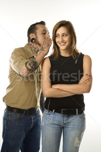 Homem sorridente menina caucasiano ouvido Foto stock © iofoto