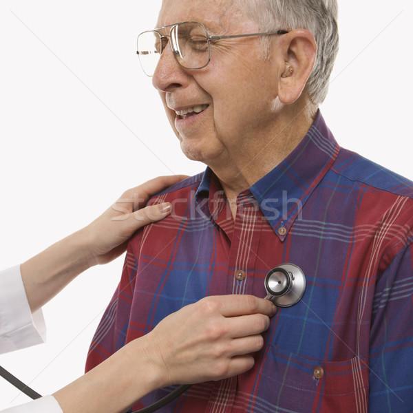 Man having physical exam. Stock photo © iofoto