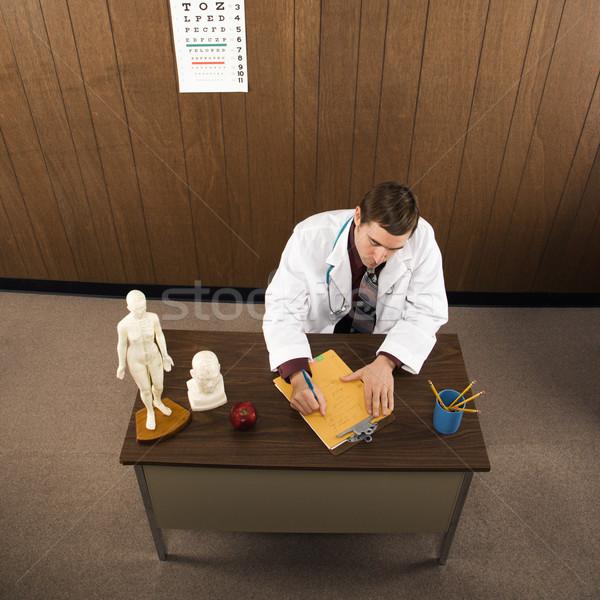 Medico file medico di sesso maschile desk Foto d'archivio © iofoto