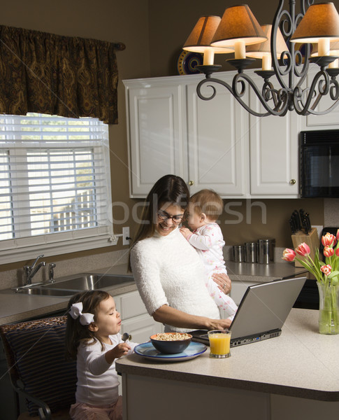 Stock photo: Mother with children.