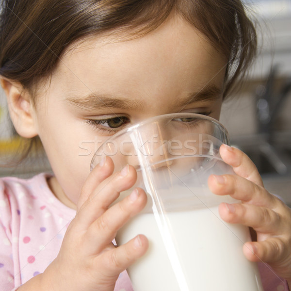 Girl drinking milk. Stock photo © iofoto