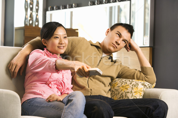 Couple regarder tv asian Homme pointant Photo stock © iofoto