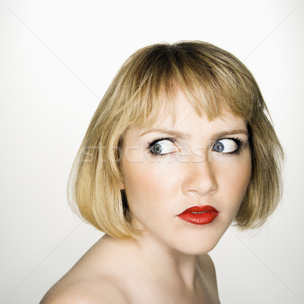 Woman looking suspicious. Stock photo © iofoto