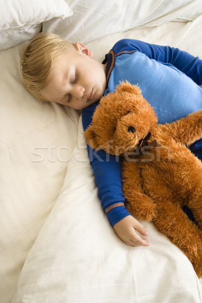 Child sleeping with teddy. Stock photo © iofoto