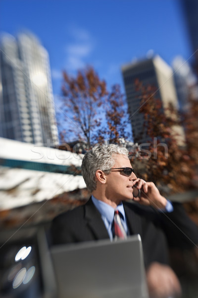 Businessman in city. Stock photo © iofoto