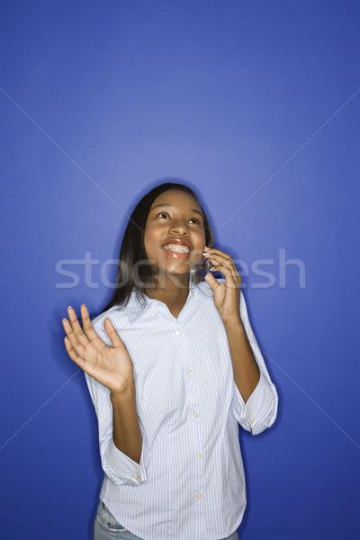 Teen girl talking on cellphone. Stock photo © iofoto