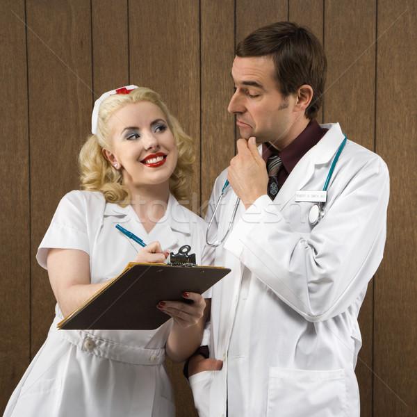 Stockfoto: Retro · verpleegkundige · arts · kaukasisch · vrouwelijke · glimlachend