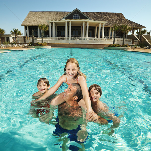 Family at pool. Stock photo © iofoto
