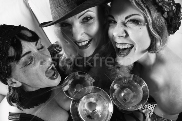 Three retro women drinking. Stock photo © iofoto