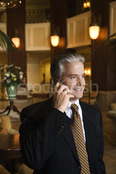Businessman talking on cellphone. Stock photo © iofoto