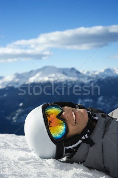 Boy snowboarder lying on mountain. Stock photo © iofoto