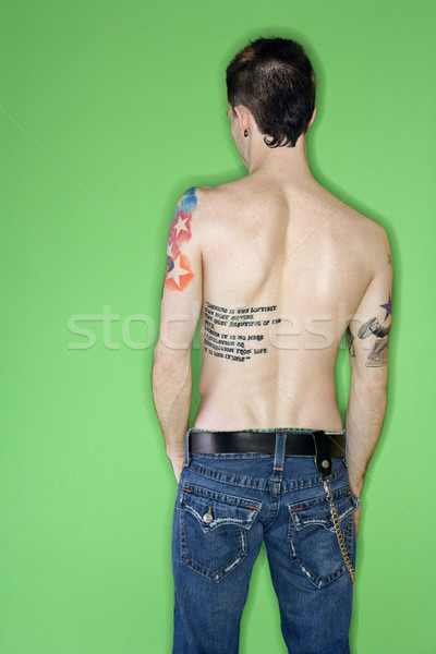 Man's back with tattoos. Stock photo © iofoto