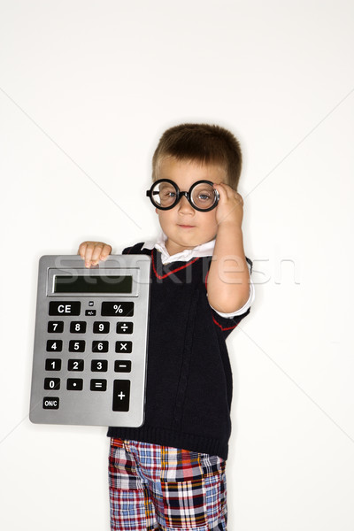 Boy child with calculator. Stock photo © iofoto