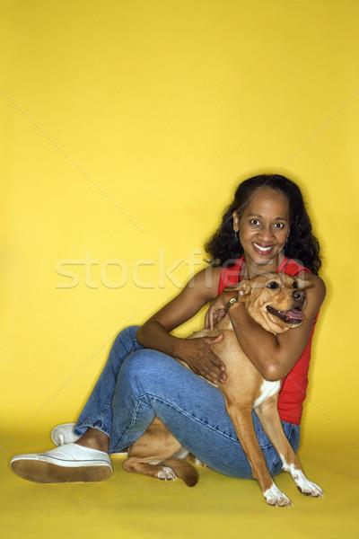 Woman with brown dog. Stock photo © iofoto