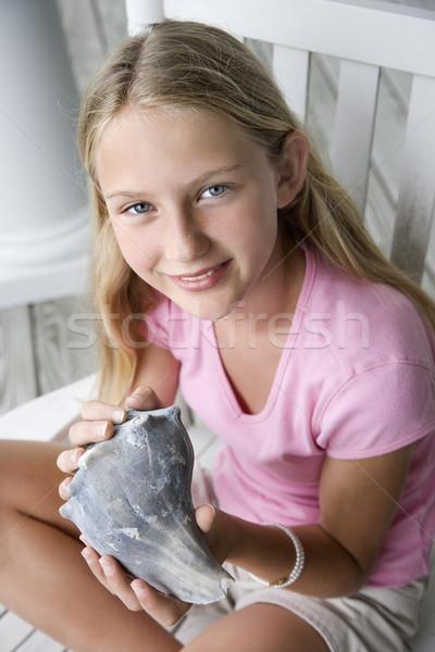 Girl holding conch shell. Stock photo © iofoto