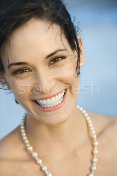 Portrait femme souriante femme perles souriant Photo stock © iofoto