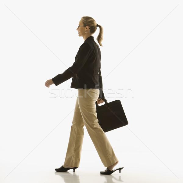 Businesswoman with briefcase. Stock photo © iofoto