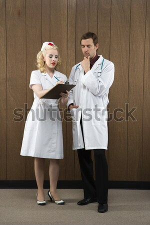 Stock photo: Nurse kissing doctor.