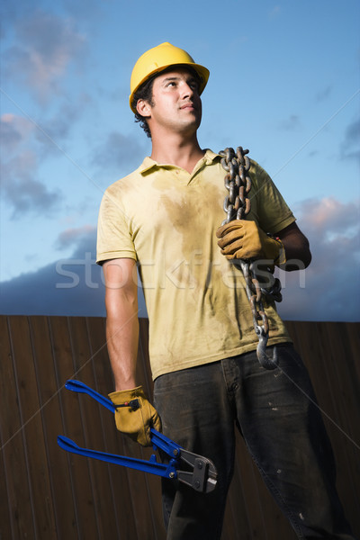 Construction Worker with Bolt Cutters and Chain Stock photo © iofoto