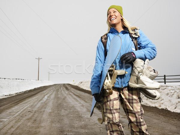 Vrouw snowboarden jonge vrouw winter kleding permanente Stockfoto © iofoto